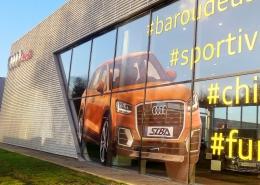Vitrophanie grand format en impession numérique sur microperforé et lettrage découpé pour concession Audi